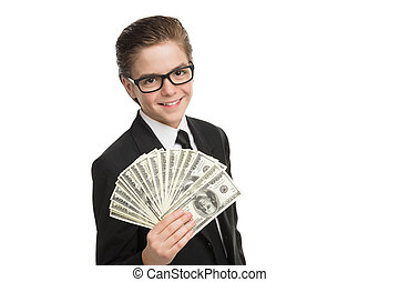 Wealthy little businessman. Cheerful little boy in formalwear holding money and looking at camera while isolated on white