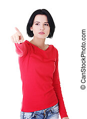 Attractive woman in red tshirt pointing up.