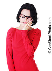 Young attractive woman in eyeglasses worried Isolated on...