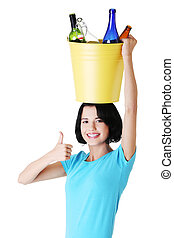 Attractive woman with bottles, recycling idea. Isolated on...