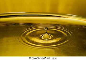 Gold Rebound - A gold sphere rebounding from the surface of...