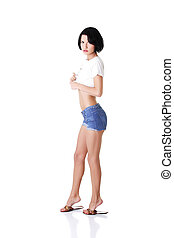 young attractive woman in shorts and tshirt.