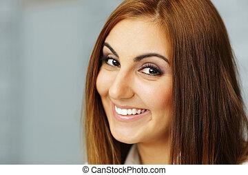 Closeup portrait of a happy beautiful woman