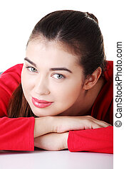 Happy casual womans portrait while lying isolated on white...