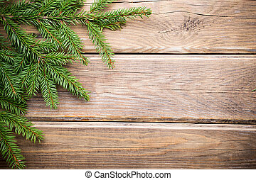 Christmas greeting card. - Spruce twigs on a wooden...