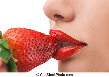 Strawberry Close-up of woman eating strawberry isolated on...