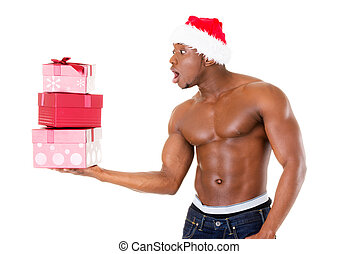 Attractive handsome nude man holding present in excitment....