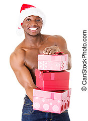 Handsome nude man holding gifts and holding santa hat....