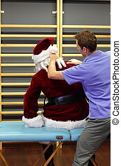 overworked Santa Claus massage - male therapist massaging...