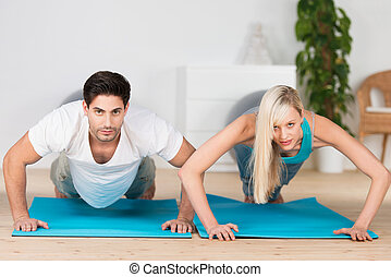 Young couple doing press ups