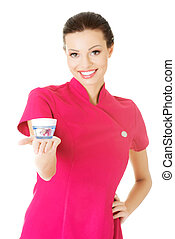 Beautiful attractive beautician holding a cream Isolated on...
