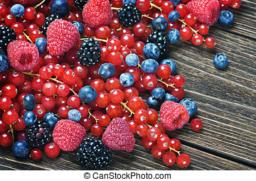 Fresh blackberries, currants, raspberries, blueberries on a...