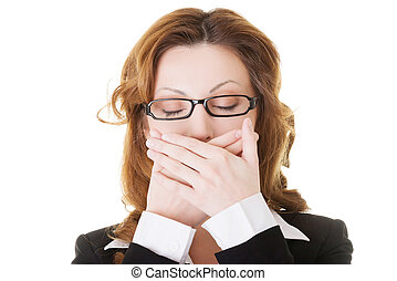 Beautiful business woman with closed eyes, covering her...