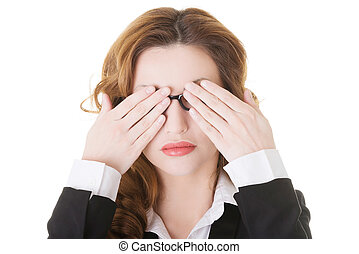 Beautiful business woman covering her eyes Isolated on white...