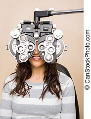 Woman Getting Eye Examination - Happy young female patient...
