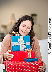 Beautiful woman appreciating the joy of Christmas