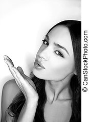 Blowing a kiss. Black and white image of beautiful young...