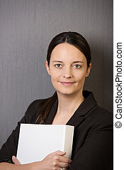 Young business executive clutching a file - Young attractive...