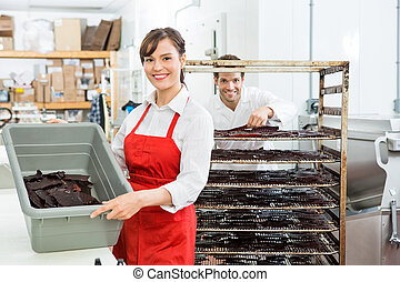 Beautiful Worker Showing Beef Jerky In Basket At Shop -...