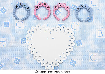 Baby Bracelets - Blue and pink baby bracelets sitting with a...