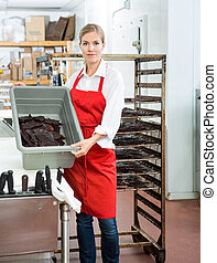 Worker, Showing, Beef, Jerky, In, Basket, At, Butcher's,...