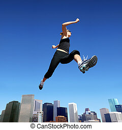 Running woman - A young blond woman jumping high above...