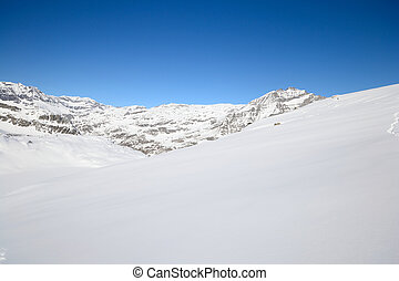 Quiet alpine scene in winter - Candid off-piste ski slope in...