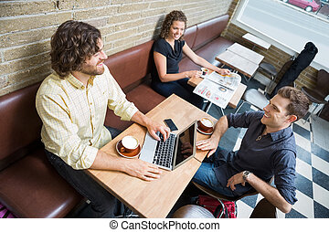 Customers Spending Leisure Time In Cafeteria - High angle...
