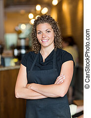 Waitress Standing Arms Crossed In Espresso Bar