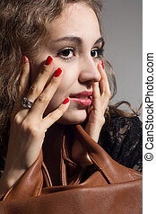 Portrait of a beautiful pensive girl with hands on face