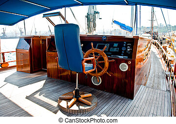 Cockpit inside a boat with a wood wheel - Cockpit inside a...