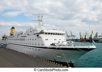 The white passenger ship in port