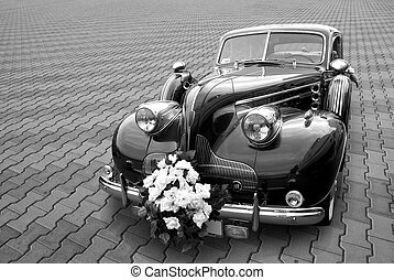 Wedding limousine on a stone blocks