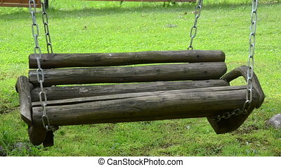 empty wooden swing chain - empty wooden swing on chain sway...