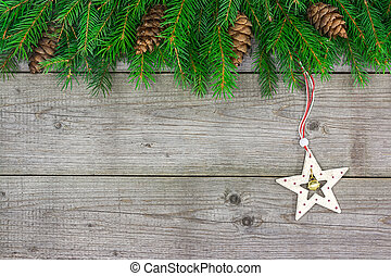 Fir tree branch with Christmas star - Christmas fir tree...