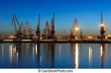 seaport at the night - View on seaport with cranes at the...