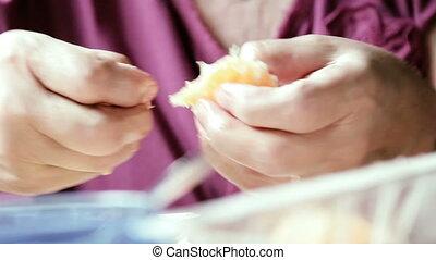 Old grandmother peeling of Orange - Peeling oranges and...