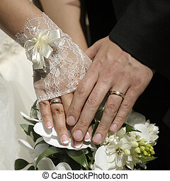 Just married couple hands with flowers