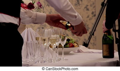Waiter Pouring Champagne on Empty glasses - Waiter in the...