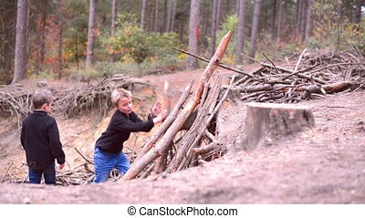kid building shanty - kids building shanty in a forest