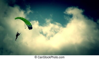 Guy on parachute lands - A guy on the neon green parachute...