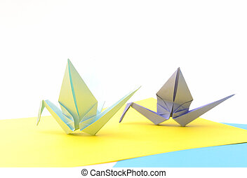 Origami birds. Child paper articles. - Origami birds over...