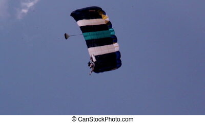 Landing on a parachute with a glide - A person on a...