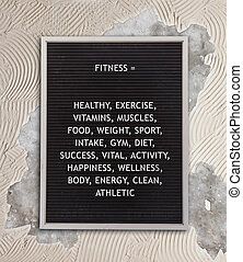 Fitness concept in plastic letters on very old menu board,...
