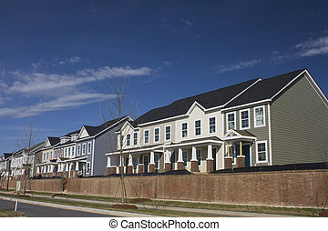 colorful row houses with mixed siding types including shakes...