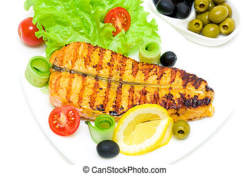 a piece of grilled fish with vegetables on the plate on a white background. horizontal photo.