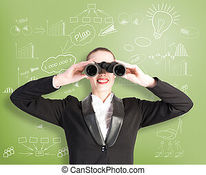 business woman looking through binoculars behind her wall...