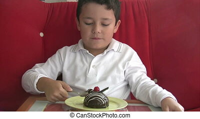 Child eating yummy cake