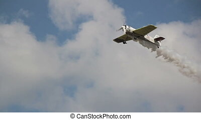 Plane take off preparing to sky-write - A plane takes off...