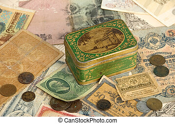 Background with old currency and box